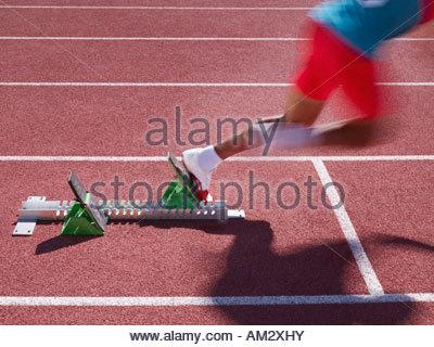 Racer at start line on track - Stock Photo