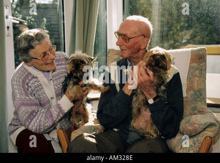 two elderly people with their pets - Stock Photo