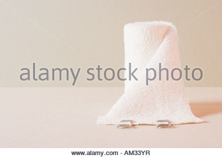 A roll of gauze sitting on a table - Stock Photo