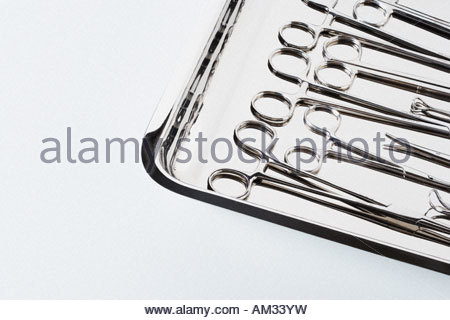 Tray full of medical scissors and forceps - Stock Photo