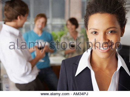 four people in kitchen with wine - Stock Photo