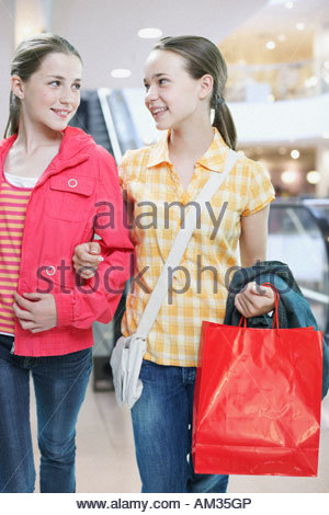 Girls shopping together in store - Stock Photo