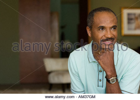 Man relaxing in modern home - Stock Photo