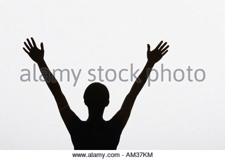 Woman with arms outstretched - Stock Photo