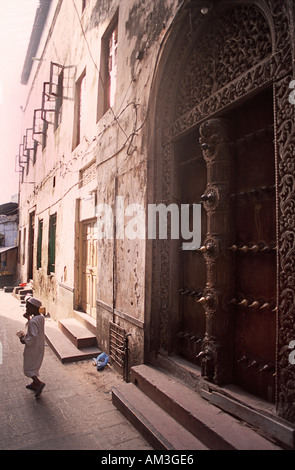 Old Stone Town is a warren of narrow streets Zanzibar Tanzania Heavy wooden doors are a characteristic feature of - Stock Photo