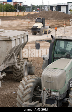Heavy earth moving machinery on building site - Stock Photo