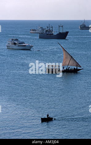 Boats in the harbour in the late afternoon Viewed from House of Wonder on Stone Towns historic waterfront Zanzibar - Stock Photo