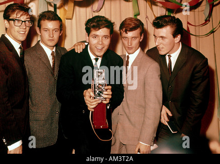 CLIFF RICHARD English pop singer with his band The Shadows at his birthday party in 1961. For names see Description - Stock Photo