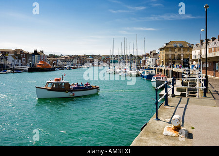 Weymouth harbour, Weymouth, Dorset, England, UK - Small pleasure trip ferry - Stock Photo