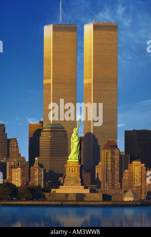 World Trade Center behind Statue of Liberty - Stock Photo