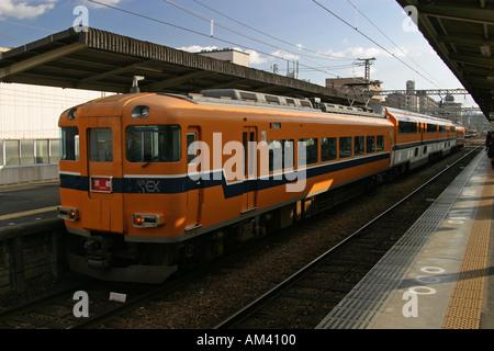 Kintetsu Super Express train waiting at a station in Osaka Japan Asia - Stock Photo