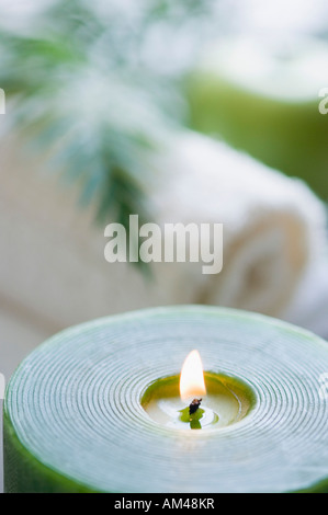 Close-up of an aromatherapy candle burning - Stock Photo