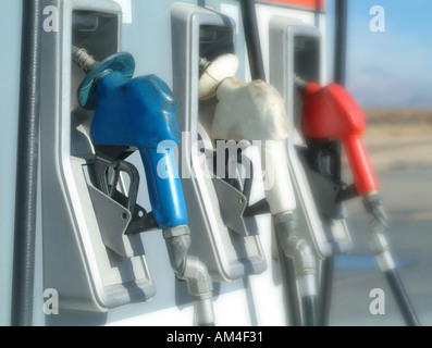fuel nozzles at a gas or petrol station - Stock Photo