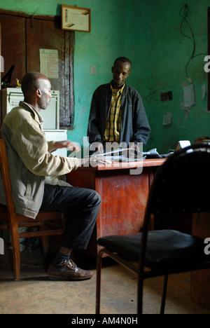 Two Ethiopian members of Afeta Wanja coffee growers cooperative working in their office, Ethiopia - Stock Photo