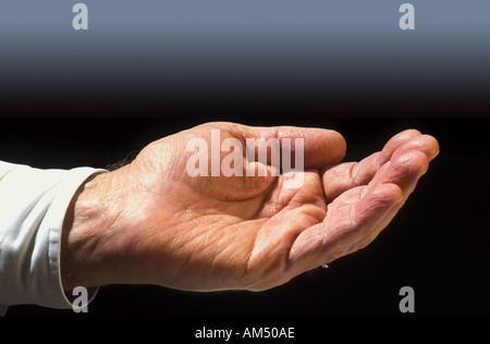 hand out as if begging or waiting for change - Stock Photo