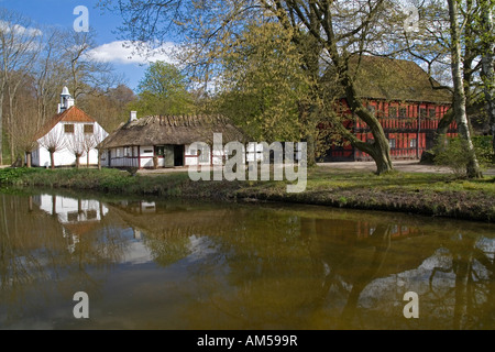 18th century Danish village with a small pond The Funen Village and open air museum Odense Denmark - Stock Photo