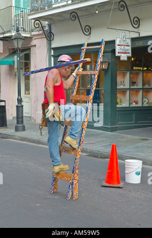 Bourbon Street area mime artist performs in French Quarter of New Orleans Louisiana - Stock Photo