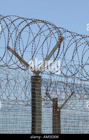 Barbed wire fence around the formerly prison on Robben Island, Cape Town, South Africa - Stock Photo