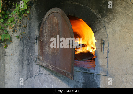 Fire in the baking oven, Bavarian Forest, Bavaria, Germany - Stock Photo