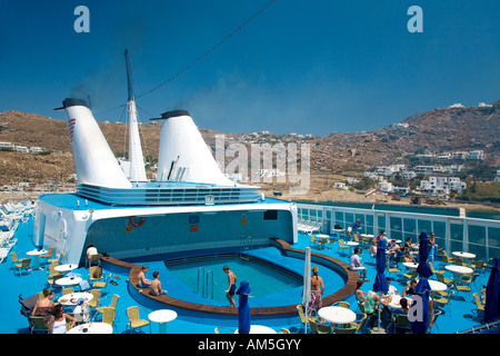 The lido deck onboard a small cruise ship with the island of Mykonos as the scenery. - Stock Photo