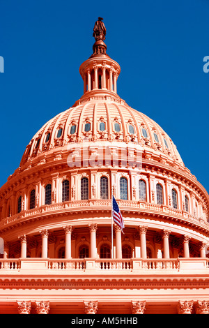 Red colored US Capitol building in Washington DC. In America the color red is a symbol for the conservative Republican - Stock Photo