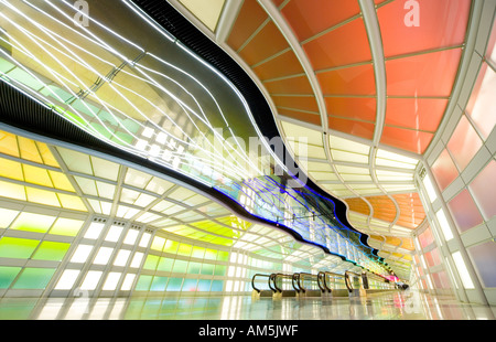 Extreme wide angle image of empty moving sidewalk in the tunnel at Chicago O'Hare airport with moving neon light - Stock Photo