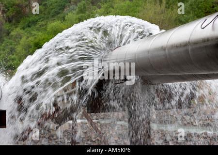 Water leak. Leaking pipes. Burst water pipes leaking drinking water, near Almaty Kazakhstan - Stock Photo
