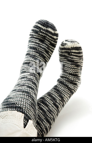 'Hand knitted' Grey and white woollen hand knitted thick tube socks - Stock Photo