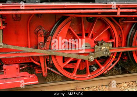Flywheel of an historical steam train - Stock Photo