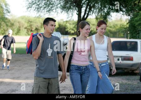 Teens walking hand in hand, Lomo Plata, Chaco, Paraguay - Stock Photo