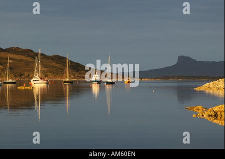 View across Loch nan Ceall from Arisaig to the Isle of Eigg, Morar, Lochaber, Highland, Scotland, UK - Stock Photo