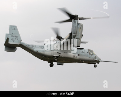 Bell-Boeing MV-22B Osprey tilt rotor aircraft of the US Marines in hover mode with engines rotated upwards - Stock Photo