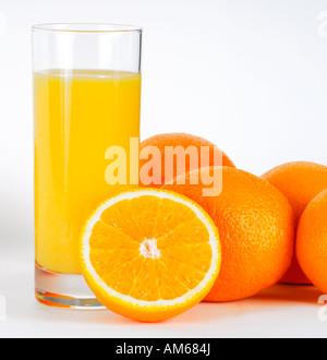Orange juice and oranges - Stock Photo