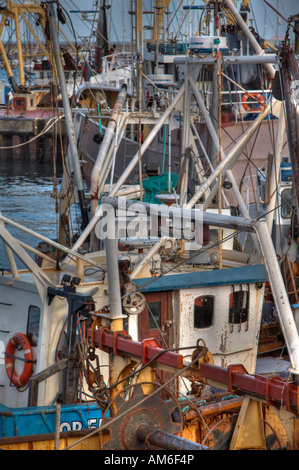 Beam Trawlers waiting for the tide to change, enabling them to go to sea. - Stock Photo