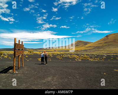 A guide with his female client in the Provincial Reserve of Payunia, Argentina - Stock Photo