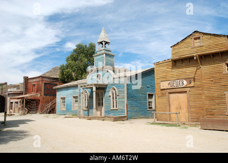 Wooden buildings in old American western style town - Stock Photo
