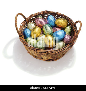A basket of foil covered chocolate eggs - Stock Photo