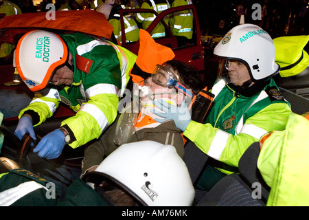 Road Traffic Accident Simulation in Chesterfield Derbyshire involving Police, Paramedics, Fire, Services and volunteer - Stock Photo