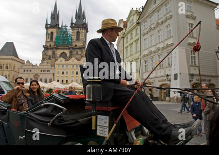 Tourists in a horse carriage in the old part of town with the Teyn church, Prague, Czech Republic - Stock Photo