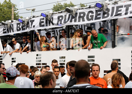 Dancing people on the float of the regional radio station 1Live, Loveparade 2007, Essen, NRW, Germany - Stock Photo