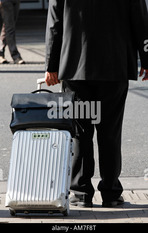 Business traveller pulling a trolley, airport Duesseldorf, NRW, Germany - Stock Photo