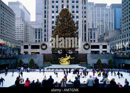 Ice-skating at Rockefeller Plaza, Christmas in New York City, USA - Stock Photo