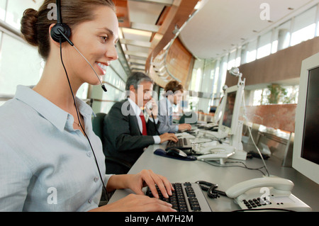 Business people working in office, smiling