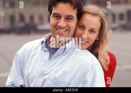 Young couple smiling, portrait - Stock Photo