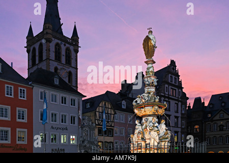 Main market place, St. Peter fountains and St. Gangolf church, Trier, Rhineland-Palatinate, Germany - Stock Photo