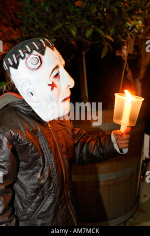 Litlle boy with Frankenstein mask holding a candle, Halloween event for children, theatre museum Duesseldorf, NRW, - Stock Photo