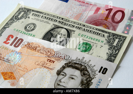 Mix of currency notes US Dollar European Euro British Pounds Sterling - Stock Photo