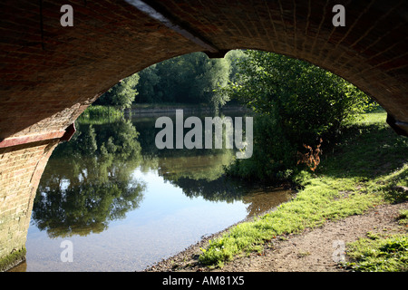 View of river Thames from beneath Sonning Bridge arch - Stock Photo