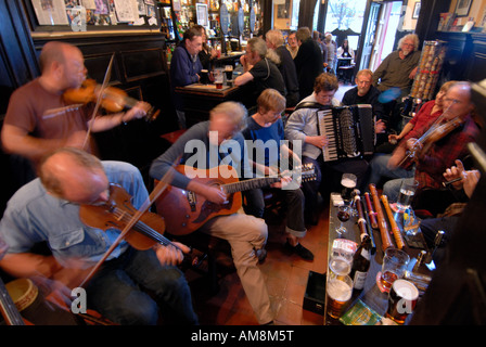 folk musicians playing during an open session at the Sandy's Bell pub in Edinburgh Scotland - Stock Photo
