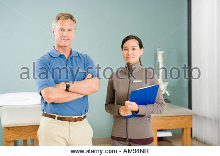 Multi-ethnic physical therapists in office - Stock Photo